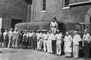 "Kentucky Peerless Distilling employees. Far right is the Master Distiller–Walter ""Bix"" Herman Bixler (1886-1958)"